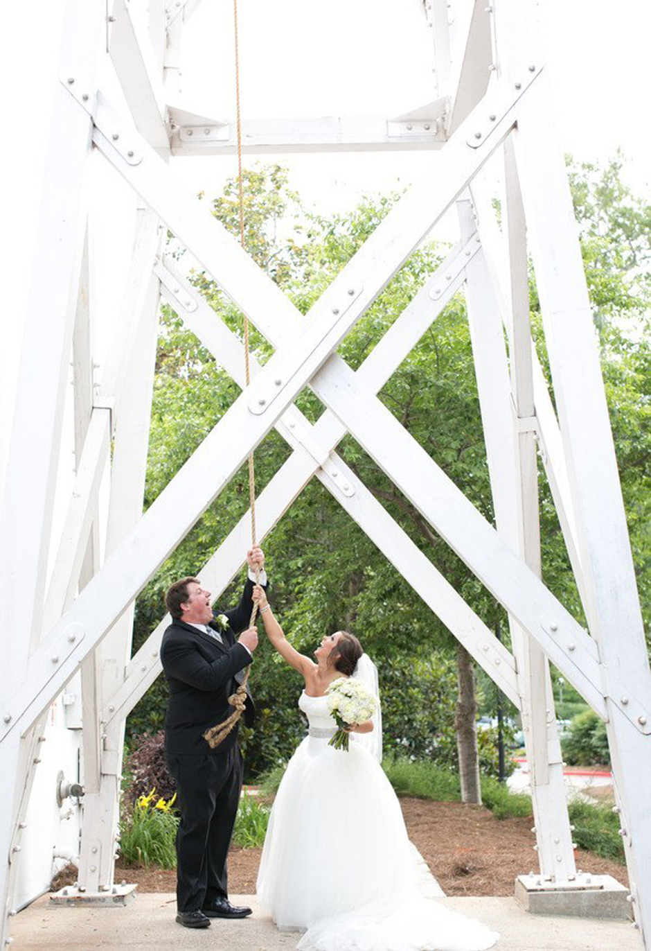 Former University of Georgia Football Player Ben Jones and new wife ring the UGA Chapel bell after their wedding ceremony - Oconee Events