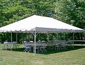 Small Frame Tent with Folding Chairs and Round Tables
