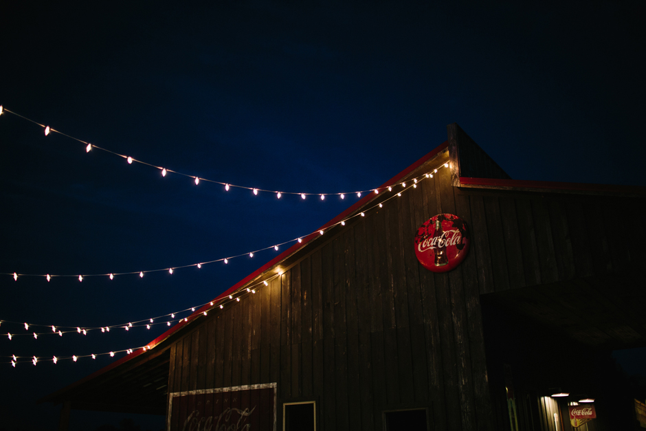 Barn with old coke sign and cafe string lighting for an event.