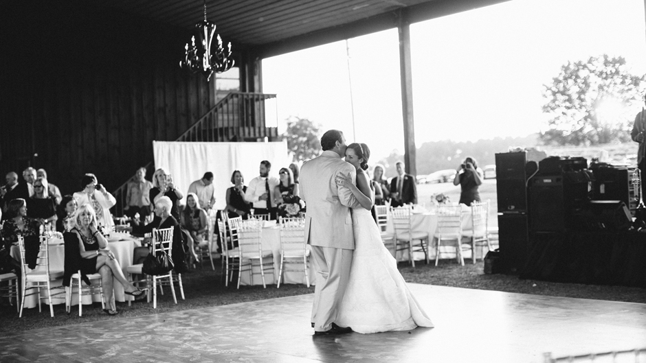 bride and groom first dance at barn wedding