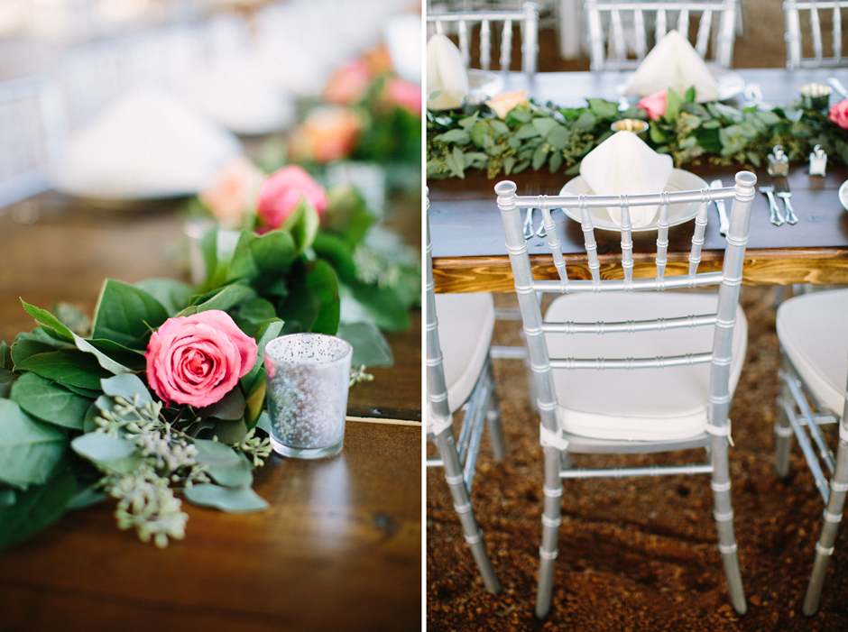Farm tables with silver chairs at barn wedding