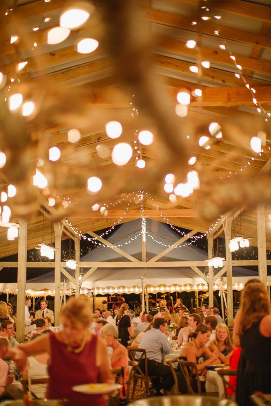 Wedding reception in barn with cafe string lights