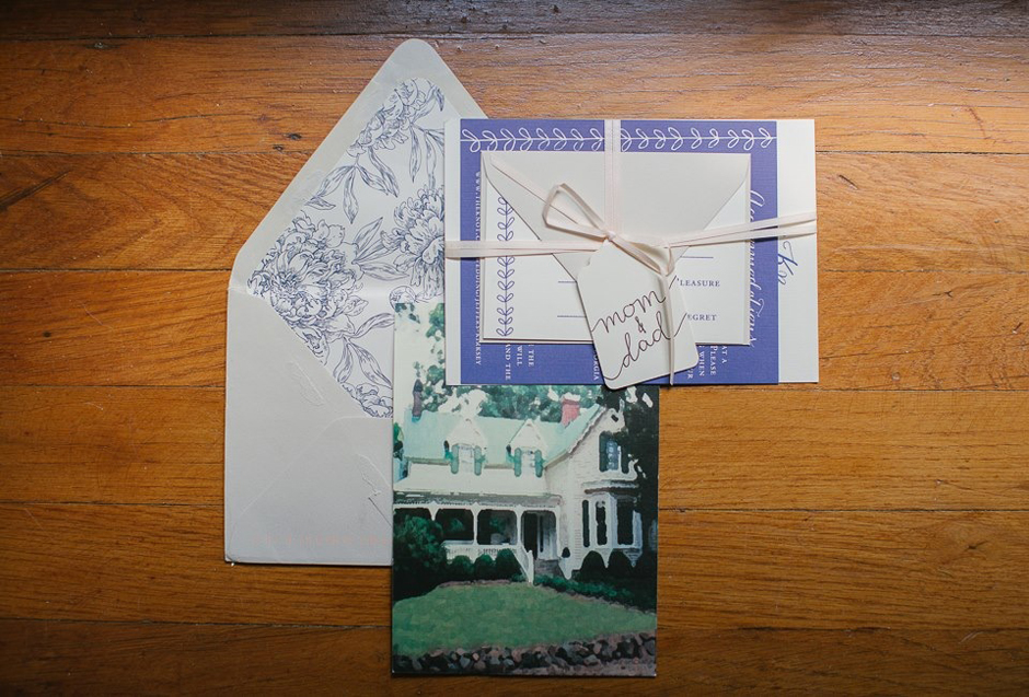 Navy blue wedding invitation including picture of the venue.