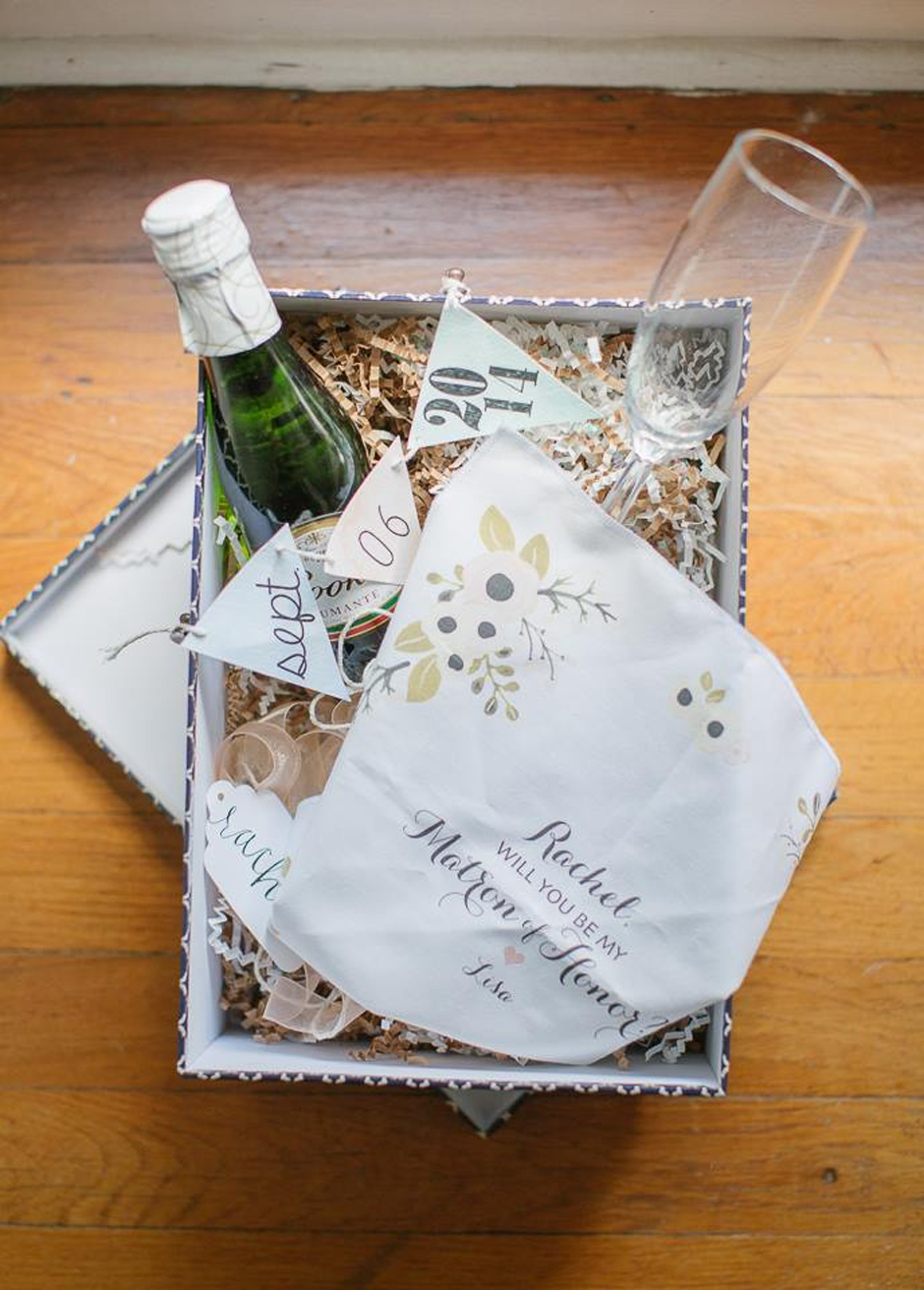Gift basket for maid of honor with champagne, crystal flute, and customized handkerchief.
