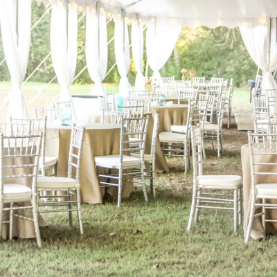silver chairs at wedding rental